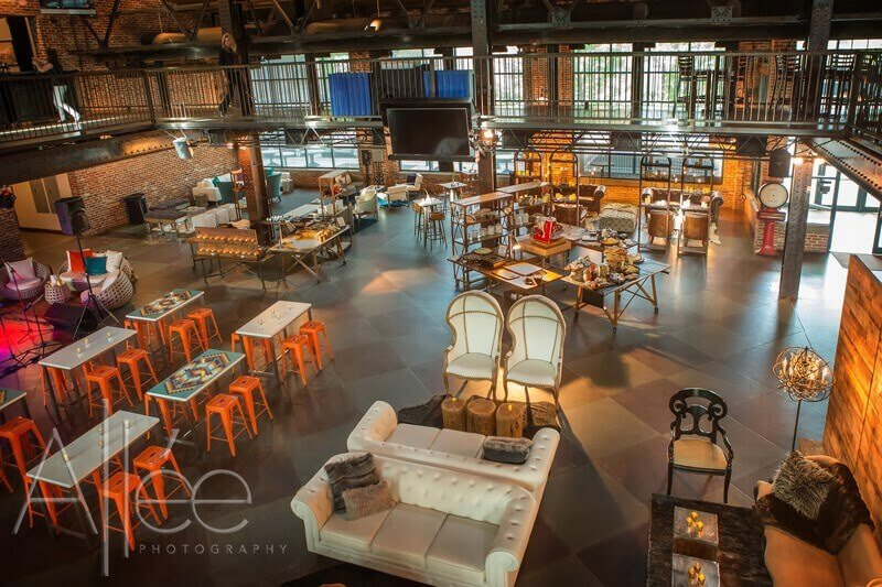 Flexible corporate event space with couches, tables, and chairs.